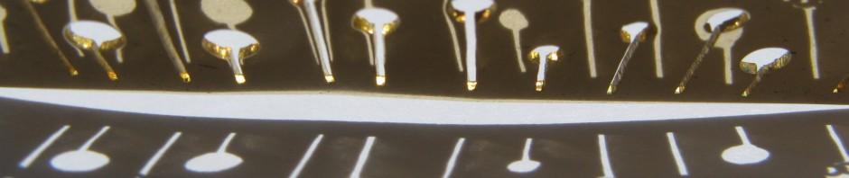 A day, necklace dandelion vertical, brass, 2014, ombres et reflets