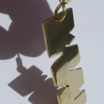 A day, earrings crocodile teeth (short) brass, 2014