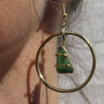 Gilded Cage, earrings, triangle green sea glass in a rond, 2016