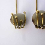 earrings,Gilded Cage, seeds (nickles) and brass, 2013