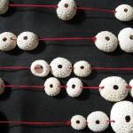 Fragile Jamaica, necklace, urchins, red cotton wire, brass, 2014