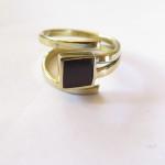 Fragile Jamaica, Cory's wedding ring (order), brass and lignum vitae, 2015