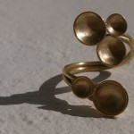 "ring, ""Planets"", meeting of two worlds, brass, 2013"