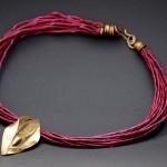 cuir bordeau et graine, bronze et cuir teinté, 2011