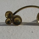 "earring, ""Planets"", shooting star, brass, 2013, 1 bis"