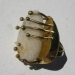 ring, Gilded Cage, oval white stone, bronze and brass, 2013